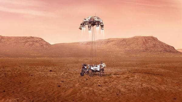 Rover Perseverance e módulo de descida tocando o solo de Marte. [3]
