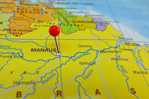 Foto do mapa do Amazonas com uma marcação em cima do município de Manaus.