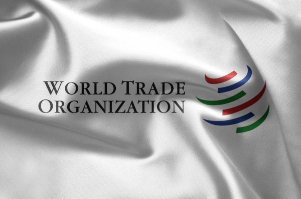 Bandeira da OMC com a sua nomenclatura em inglês.