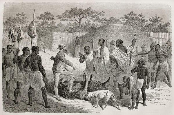 Ilustração que retrata colonizadores europeus em contato com povos de uma região da África Central.