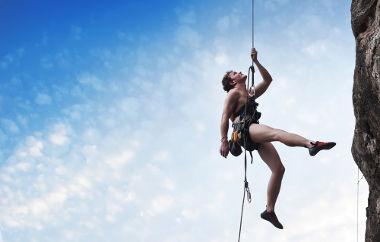 Nessa imagem, a tração na corda corresponde à força peso do alpinista
