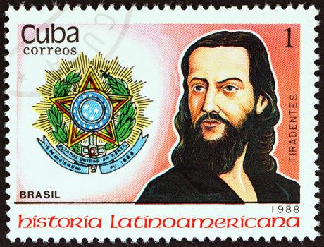 Neste selo cubano de 1988, Tiradentes foi representado com traços semelhantes aos idealizados para Cristo *