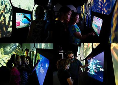 Os visitantes podem se divertir com jogos em telas interativas no Centro de Visitantes do Parque dos Corais de Búzios. (Créditos: Agência Petrobras / Marcelo Vallin)