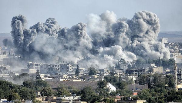 Ataque americano contra o Estado Islâmico na cidade de Kobani, em 2014 *