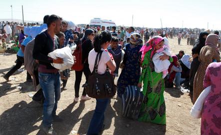Milhares de refugiados curdos foram para a Turquia saídos da Síria
